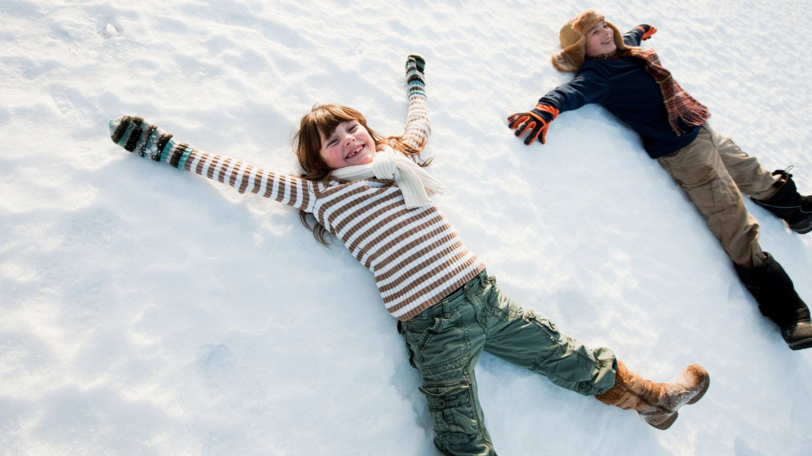 Things to Do in Calgary - Kids Playing in Snow